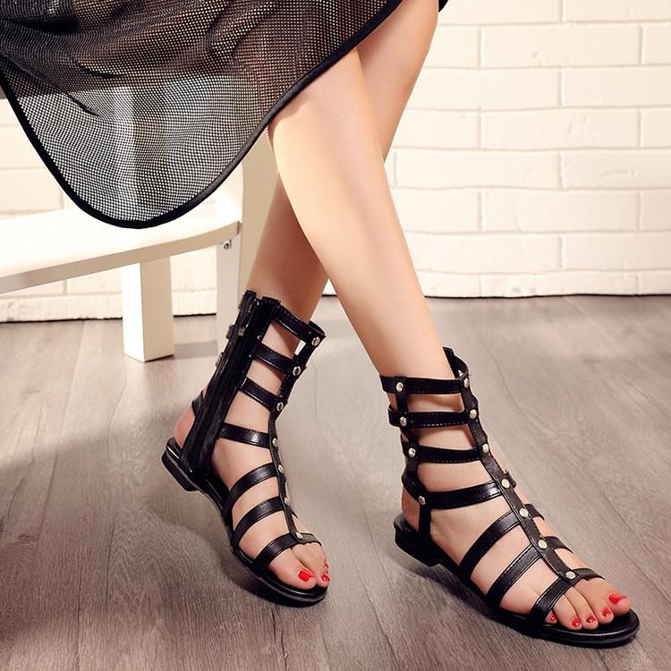 Stylish Open-Toe Rivet Decoration Hollow-out Flat Low Heel Black PU Gladiator Sandals
